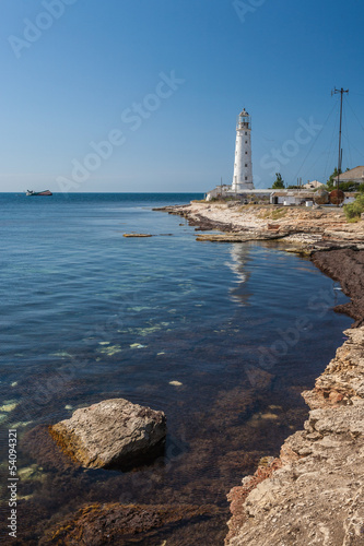 Lighthouse, sea and rock, blue sky