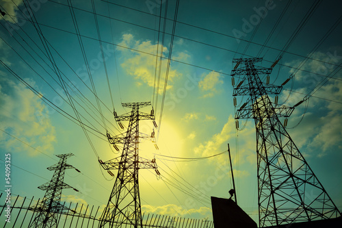 Transmission tower on Sun sky background