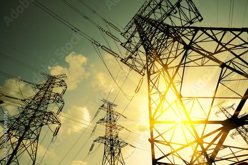 Leinwanddruck Bild The power transmission towers of sky background