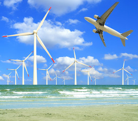Aircraft is flying in eco power of wind turbines in the sea skyl