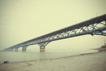 Blue steel bridge across the water in nanjing jiangsu