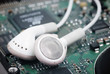 white earphones on electric circuit of sound card