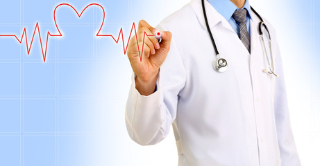 Medical doctor draws cardiogram on blue background