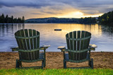 Fototapety Wooden chairs at sunset on beach