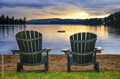 Wooden chairs at sunset on beach