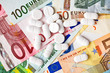 pills and euro banknotes