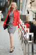 Young businesswoman walking on the city street