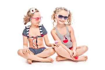Two young and beautiful girls in bathing suits