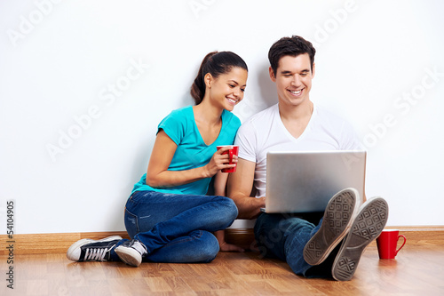 couple laptop floor