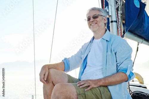sitting on boat man