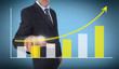Businessman touching a growing chart