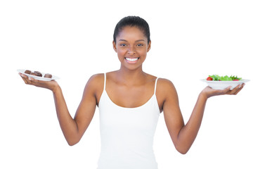 Happy woman deciding to eat healthily or not