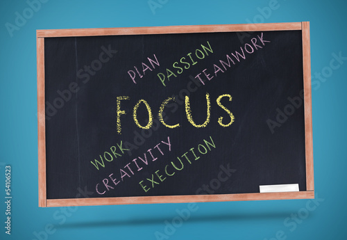 Focus terms written on chalkboard with a chalk
