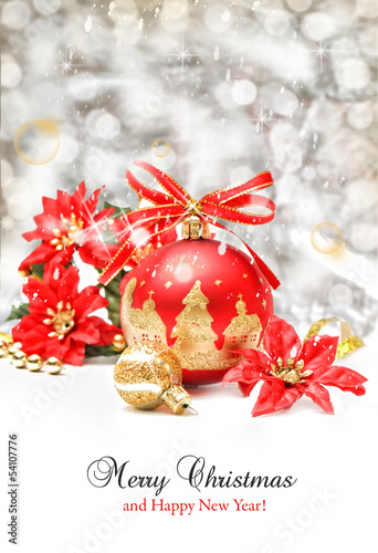 Red and gold  Christmas ball on abstract light background