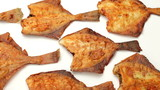 flounder fish fried on frying pan , tasty and healthy fish food poster