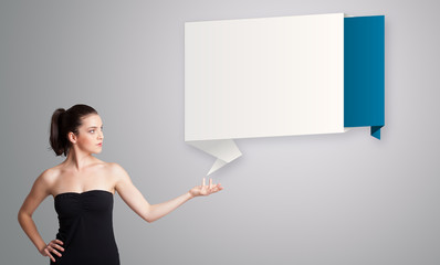 woman presenting modern origami copy space