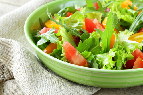fresh healthy salad with tomatoes and arugula