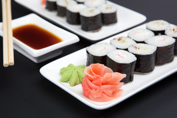 Set of japanese sushi on black