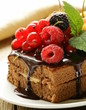 chocolate cake with berrie and chocolate sauce