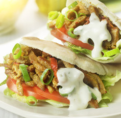 pita stuffed with shawarma tomato and lettuce