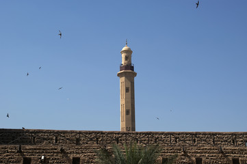 Old Fort and  tower of a nearby mosque. Dubai