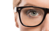Close up of female eye with glasses isolated on white background