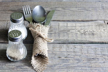 Cutlery kitchenware on old wooden boards background food concept