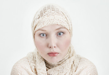 Russian girl in gold scarf on her head