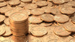 Layer of golden coins with stack of coins with DOF
