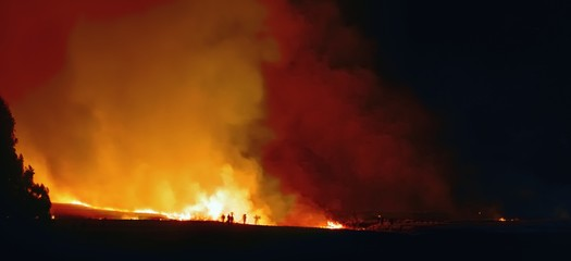 Fire-fighters on a night time blaze in the Drakensberg,
