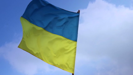 Flag of Ukraine on flagstaff. Ukrainian national flag.