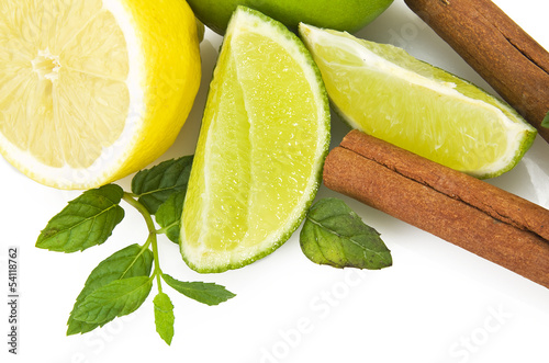 Lime,lemon and fresh leaves of mint on white