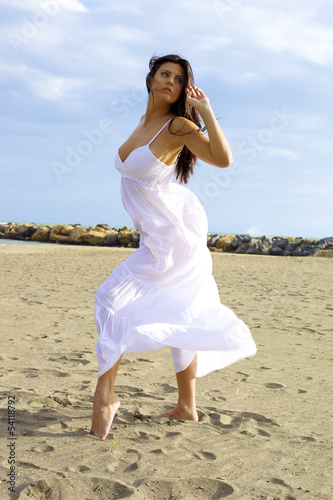 Beautiful dancer posing on the beach