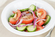 served plate with mix salad from tomatoes and cucumbers