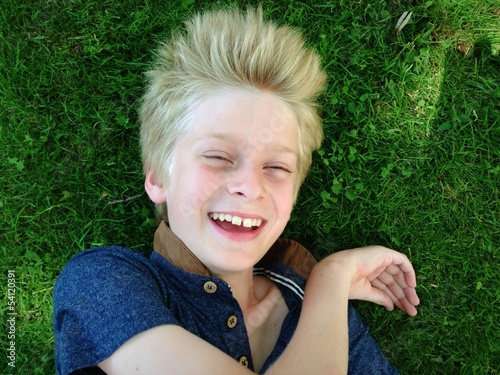boy lying on grass