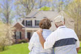 Retired Senior Couple Looking at Front of House