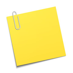 Yellow sticky note clipped with a paperclip
