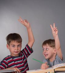 enthusiastic schoolboys raising their hands, education concept
