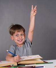 enthusiastic schoolboy raising his hand, education concept