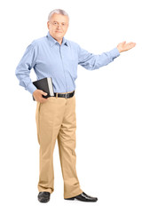 Full length portrait of a male teacher holding a book