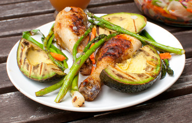 Summer dinner outside with grilled chicken and vegetables