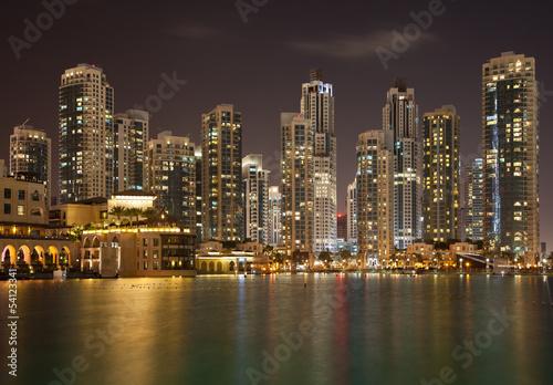 Dubai Skyline and Reflection of Illuminated Skyscrapers on Water