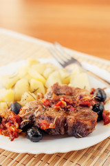 Pork provencal with baked potatoes