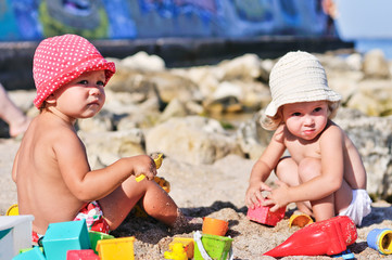 baby girls with sand