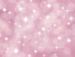 Abstract pink background with boke effect and stars