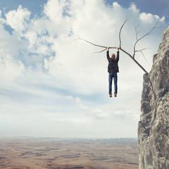 man climbs a rock