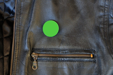 black leather jacket with pin badge