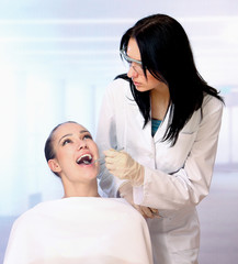 Young female patient takes a dental attendance