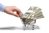 businessman's hand & steel grocery cart full of money stacks