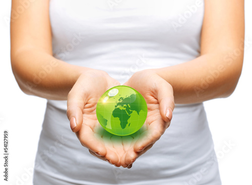woman hands holding green sphere globe